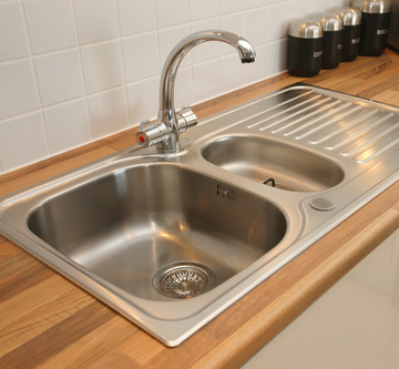 Do I Unclog A Kitchen Sink How to unclog a kitchen sink like a pro next put the trap back on the drain and test out the sink if the sink does not drain freely repeat the drain augering until you have successfully cleared workwithnaturefo